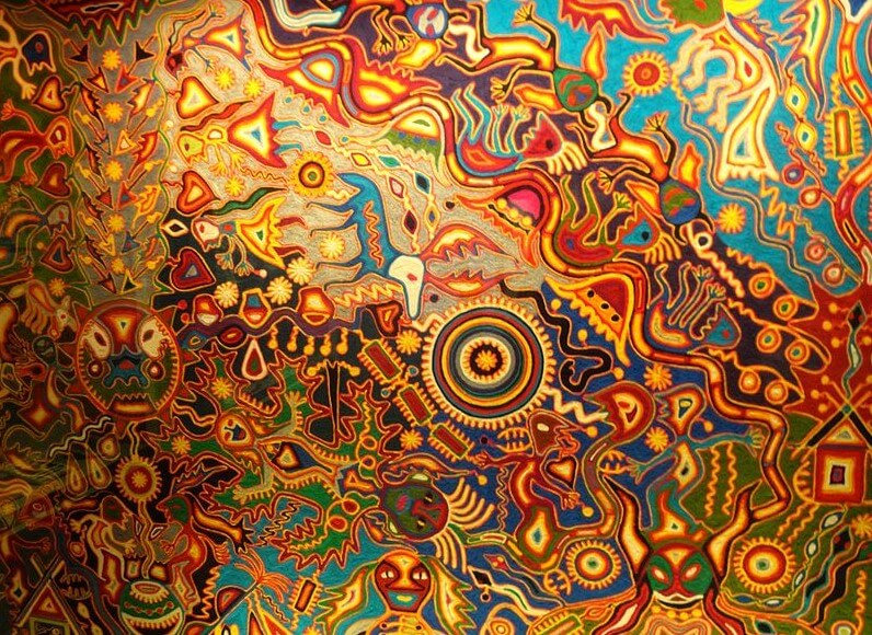 Colorful and intricate art work constructed with beads and string by a Huichol Indian.