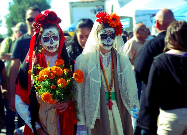 Girls dressed in Day of the Dead costumes